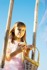 girl with curly hair wearing  having fun on a swing