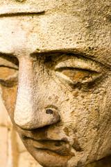 detail of a sandstone face sculpture