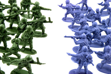toy green and red army men standing opposite one another