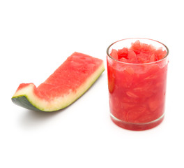 cup of fresh watermelon juice and one finished skins on white