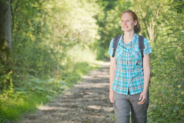 Active Woman Hiking in a Forest