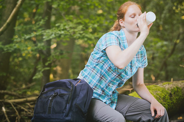 Woman on a Hiking Trip Drinking Water