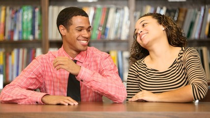 Two young couple laugh and joking