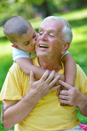 canvas print picture happy grandfather and child in park