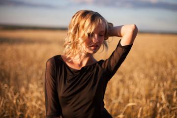 Happy woman in golden wheat