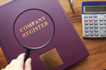 Company Register under magnifying glass