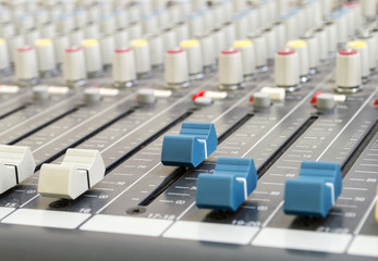 Closeup of audio mixing console