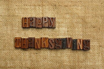 Happy Thanksgiving written with wooden letters on burlap