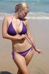 Beautiful woman with a bikini posing at the beach