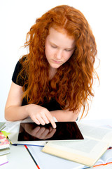 girl is learning with books and tablet PC