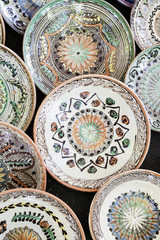 Traditional ceramic plates exposed to a fair