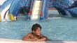 Child in aqua park smiling to a camera