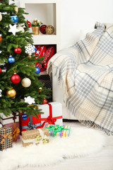 Decorated Christmas tree on home interior background