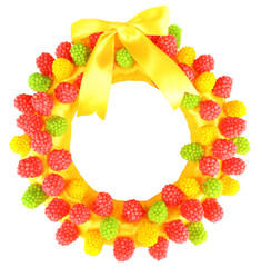 Beautiful wreath of candies, isolated on white