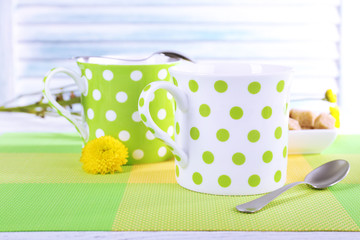 Two polka dot cups with sugar and wildflowers