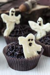 Halloween treats, chocolate muffins with  sweet white chocolate