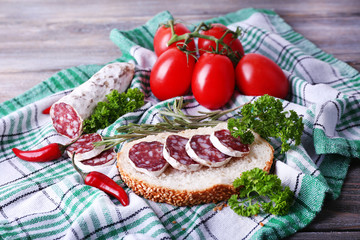 French salami with bread, tomatoes and parsley