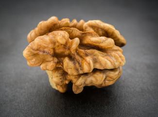 Kernel walnut on dark background. Selective focus.