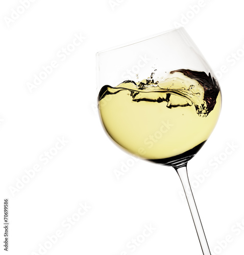 Papiers peints Vin Moving white wine glass over a white background