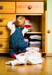 Domestic chores - baby throws out clothes