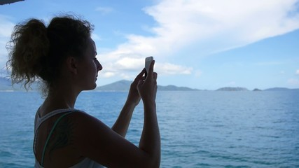 Girl Taking Picture of Seascape by Phone Camera. Slow Motion.