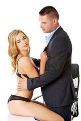 Seductive woman and man - office romance concept