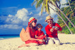 family making self photo on the beach using phone