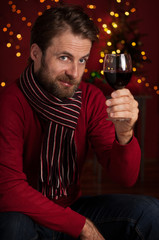 Christmas - man with a glass of wine proposing a toast