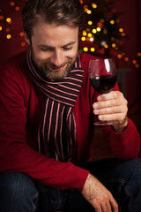 Christmas party - smiling man drinking wine
