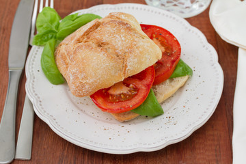 bread with tomato and basil on plate