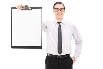 Elegant businessman holding a clipboard