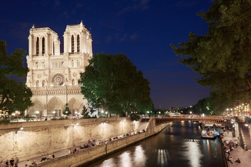 Notre Dame at night with people, Paris