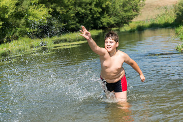 Full 10 years boy swim in  river