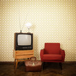 Vintage room with old fashioned armchair, retro tv, lamp and bag