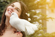 Wedding, young beautiful bride outdoor with pigeon. Toned and no
