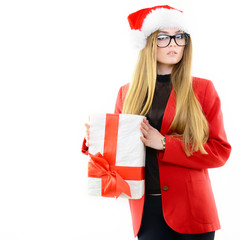 Attractive cheerful fashion girl in Santa's hat holding gift box