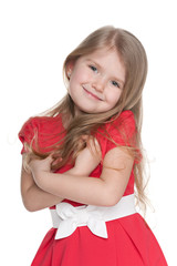 Funny little girl in a red dress