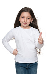 Fashion young girl holds her thumbs up