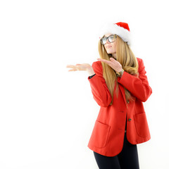 Attractive cheerful fashion girl in Santa's hat pointing at copy