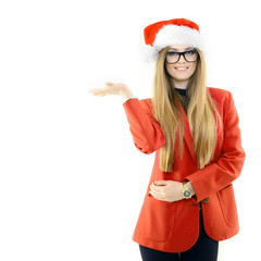Portrait of attractive cheerful fashion girl in Santa's hat poin