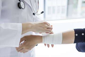 Women are wound a bandage to doctor