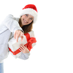 Portrait of attractive cheerful girl in Santa's hat holding gift