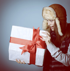 Portrait of attractive excited christmas girl in winter hat open