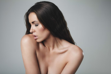 Seductive young woman topless
