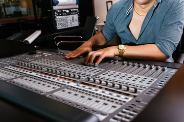 Hands of sound engineer