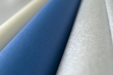 Rolls of Silver, Blue and Gold Luxurious Textured Paper