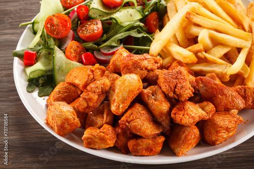 Deurstickers Klaar gerecht Fried chicken nuggets, French fries and vegetables