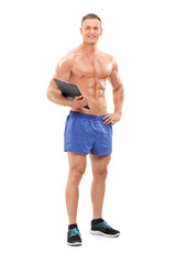 Full length portrait of a handsome male fitness coach