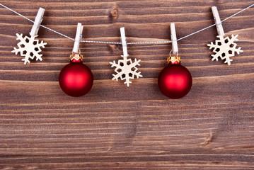 Christmas Decoration on a Line on Wood