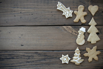 Decorated Ginger Bread Cookies on Wooden Plank